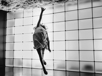 girl jumping towards the sky